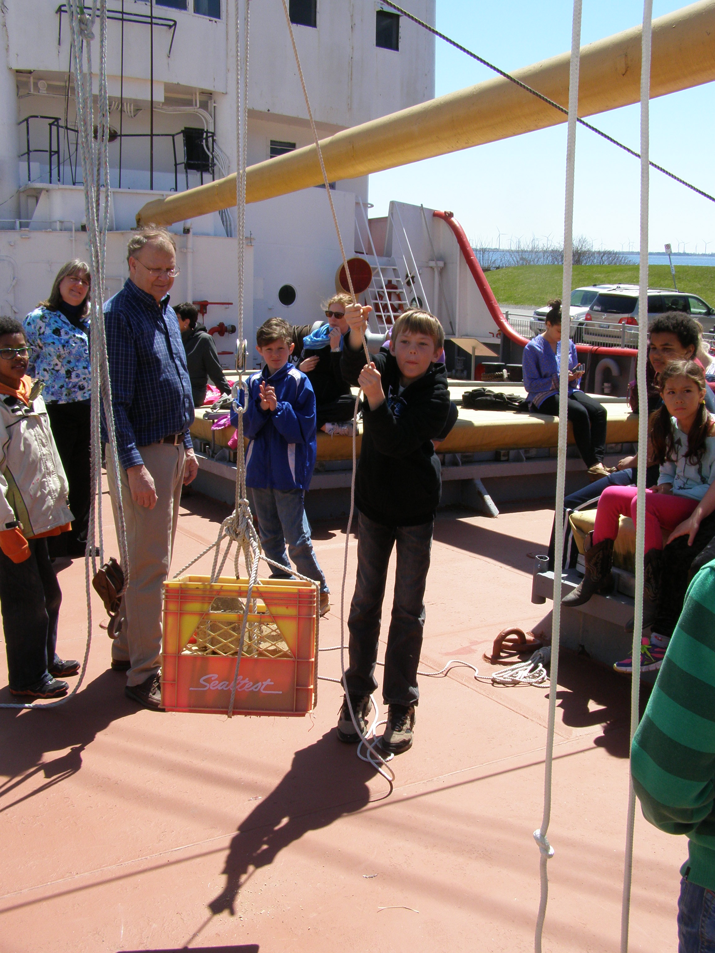 Student learns about pulleys at Marine Museum of the Great Lakes